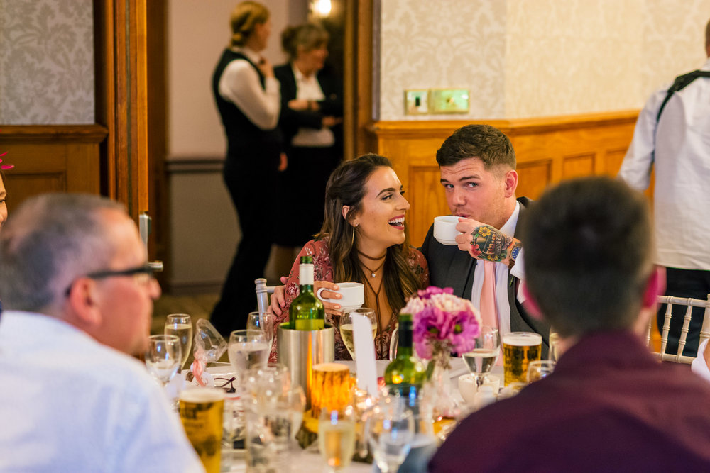 a couple have fun during the wedding breakfast