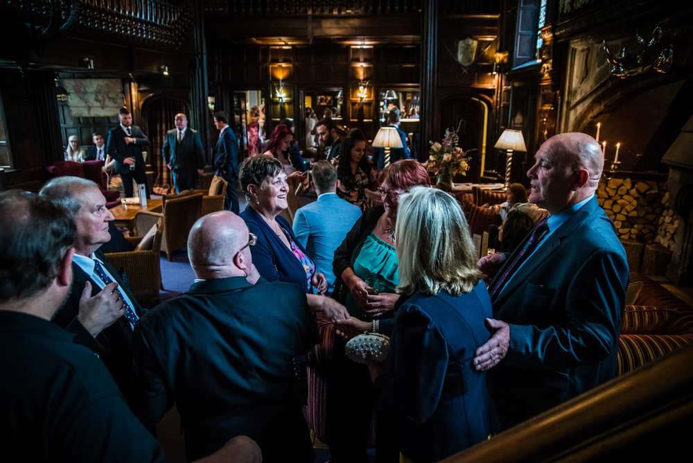 Wedding guests gather to have a drink