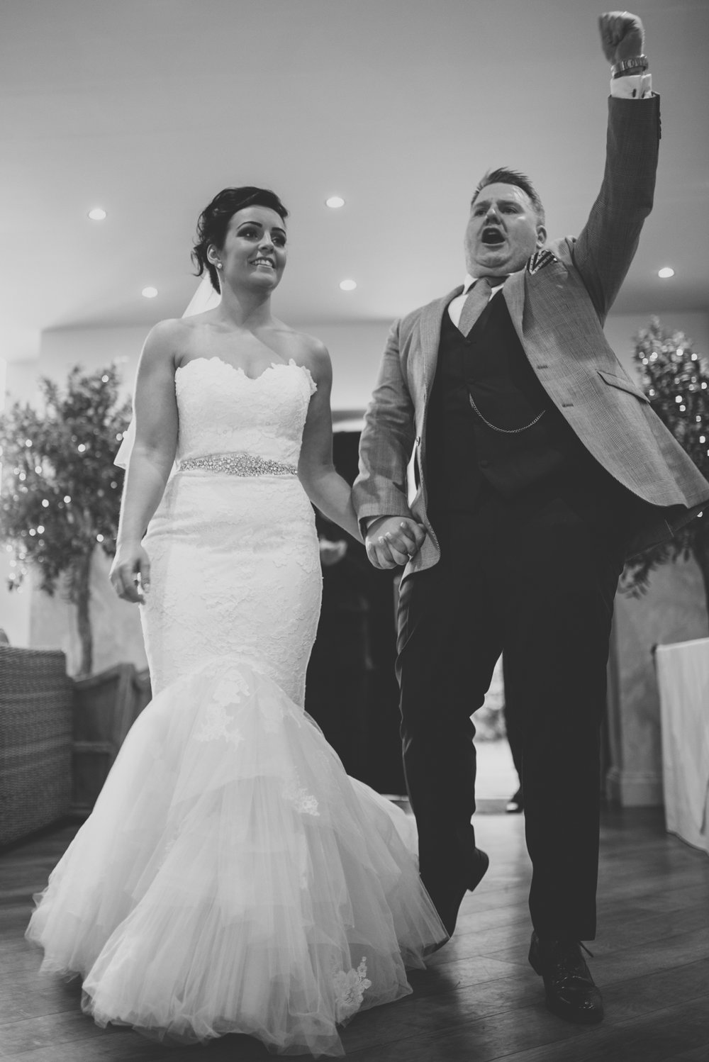 Bride and groom walk down the aisle together