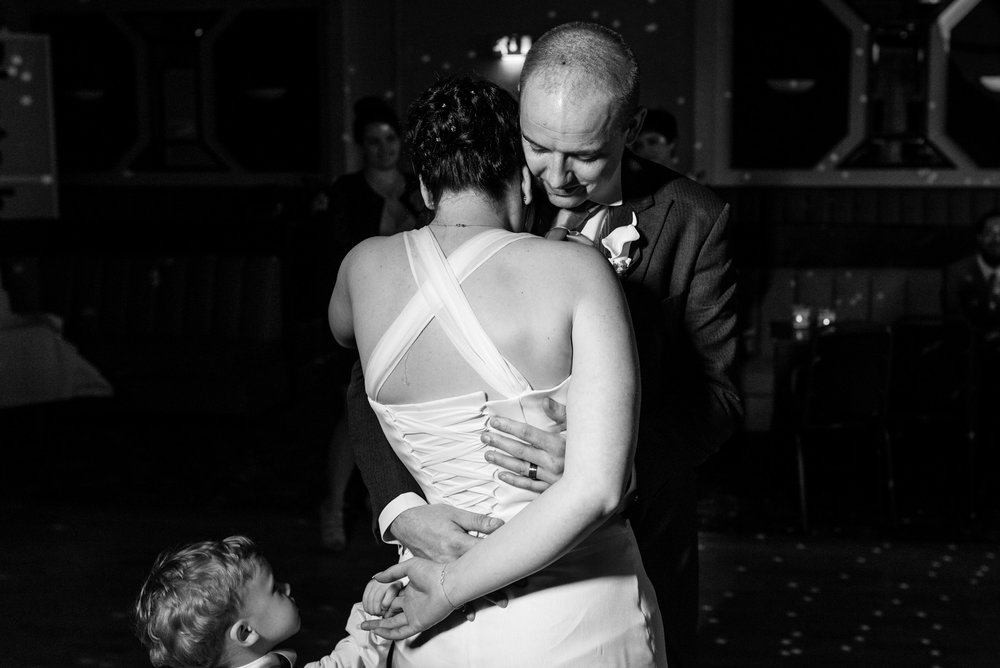 Bride and groom's first dance, joined by their little son.