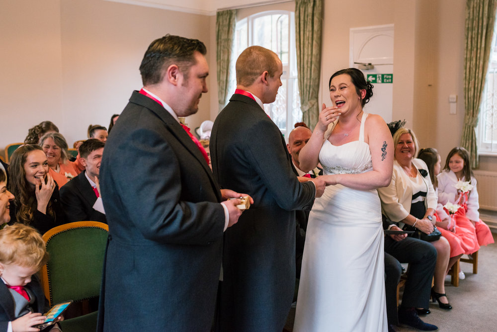 Bride laughs at a mistake the Groom makes during his vows.