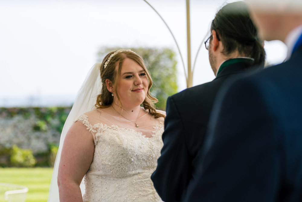 Bride looks into the eyes of her groom during the vows