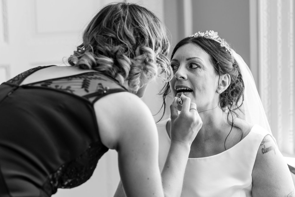 Touching up the Bride's make up