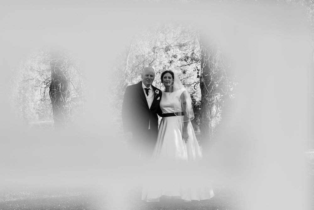 Bride and groom - taken through some railings
