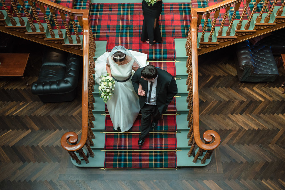 Bride and her son going down the stairs