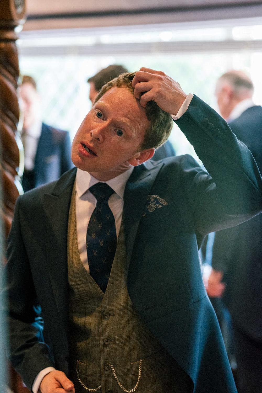 Groom sorting his hair