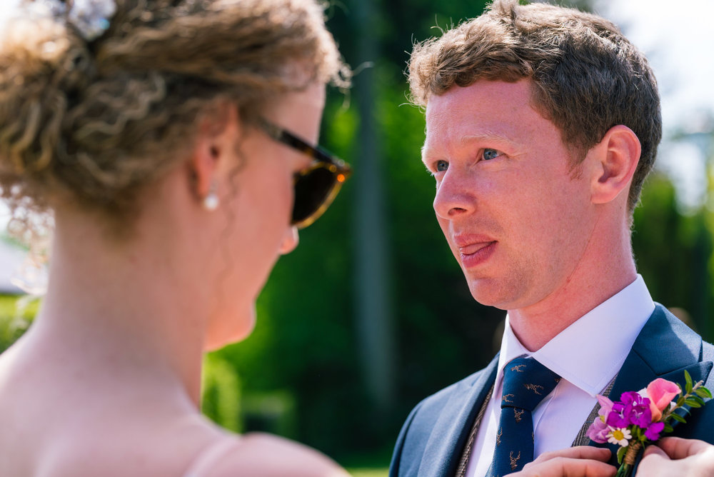 Groom gets his button hole fixed