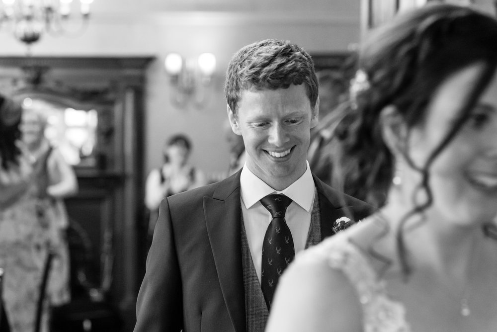 Groom following his new wife to the top table