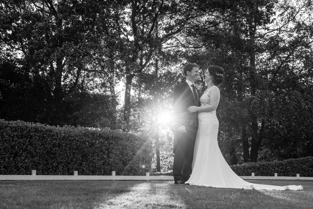 The happy couple backlit by the sun