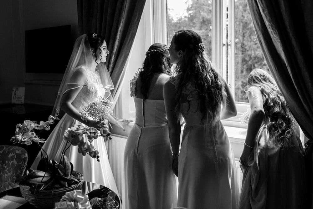 The bride checks out the window