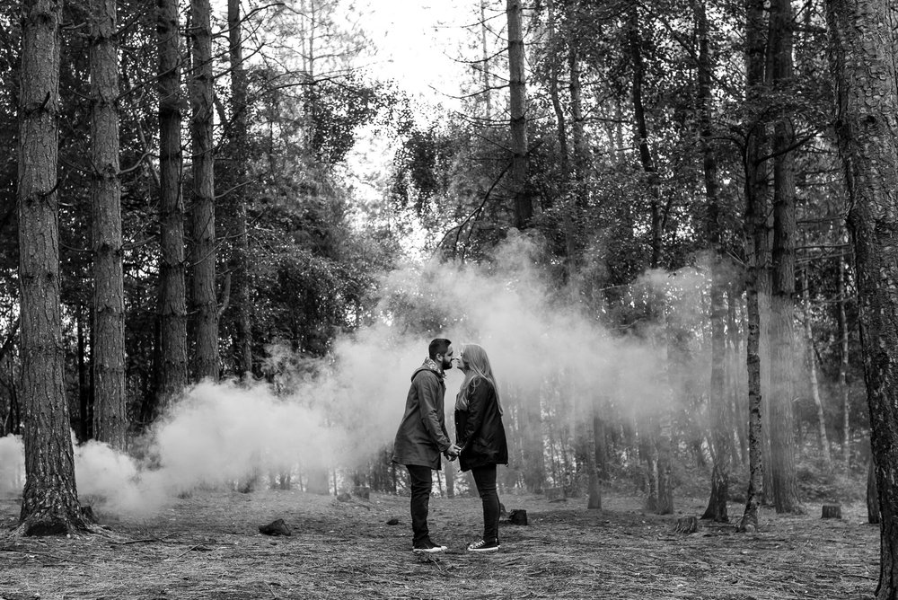 Kissing in front of a smoke grenade
