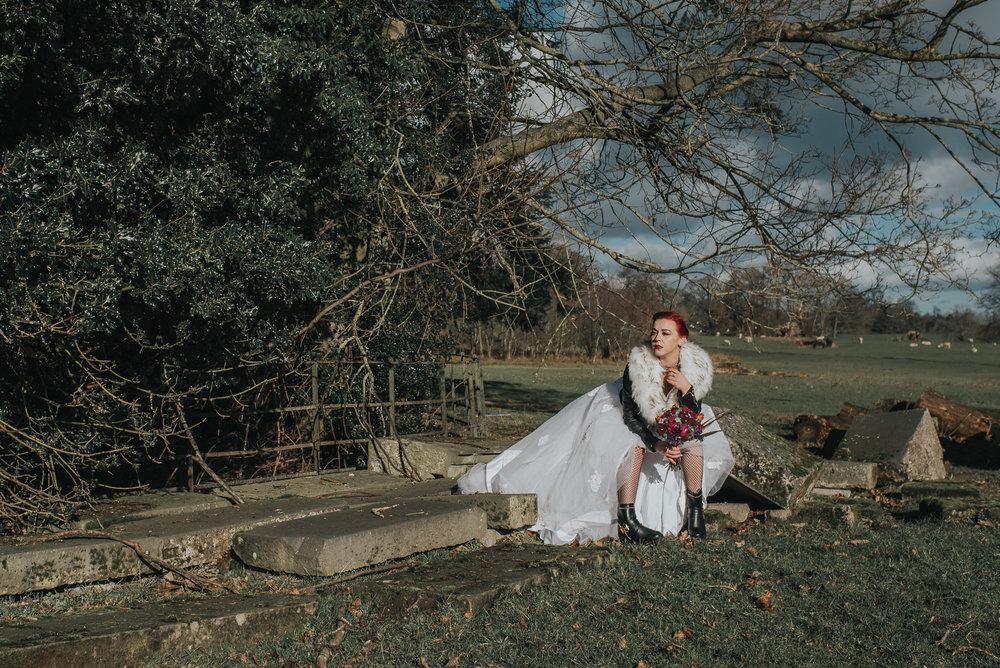 Long shot of bride sitting
