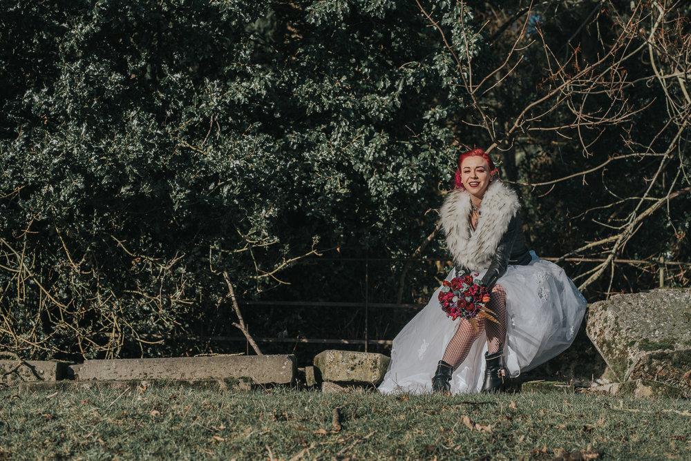 Wide shot, happy bride sitting