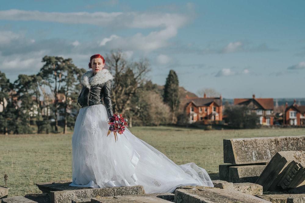 Bride standing on rocks