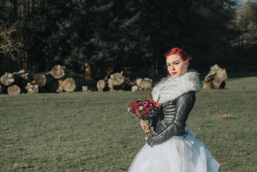 Bride, leather jacket and bouquet