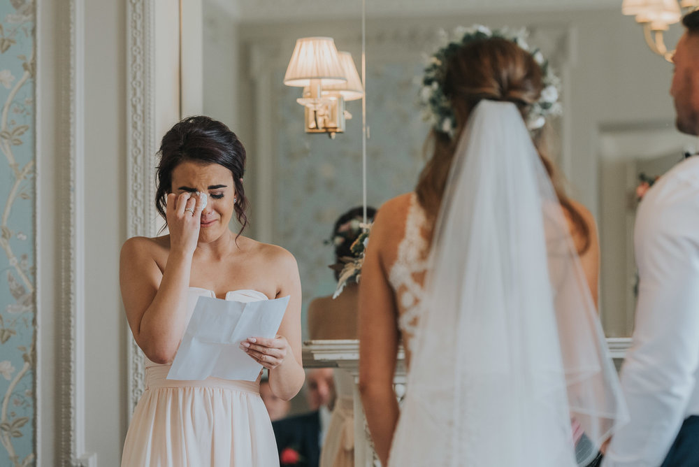 Emotions run high during a speech by a bridesmaid during the wedding ceremony