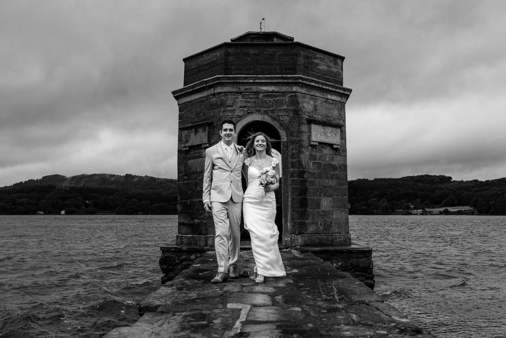 Landing stage on lake windermere for a summer wet and windy wedding