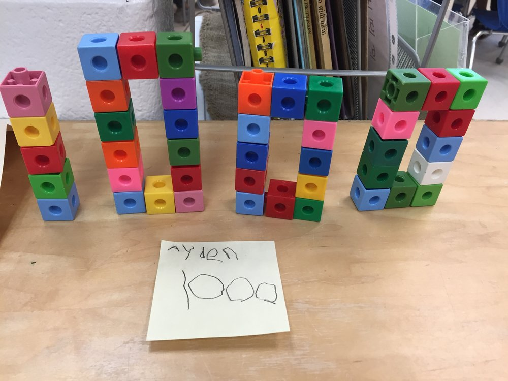 Here a student made a number using linking cubes. Students could also use the cubes to practice on-to-one correspondence by lining up the cubes and using their finger to count each one.
