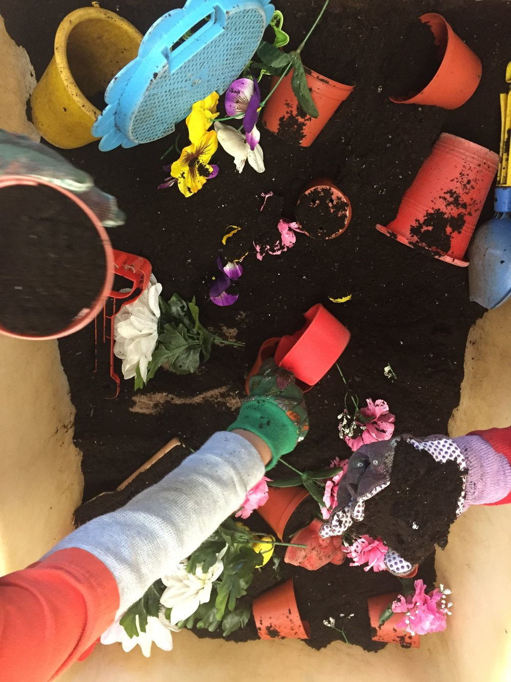This may be one of the students favourite sensory bins- though not my favourite to have to sweep up! I like using the gloves because they are theme appropriate and they save time and mess when cleaning up their hands. I like to include plastic flowers, mini pots, and scooping tools. This would also be a fun center to add to a flower shop themed dramatic play center.