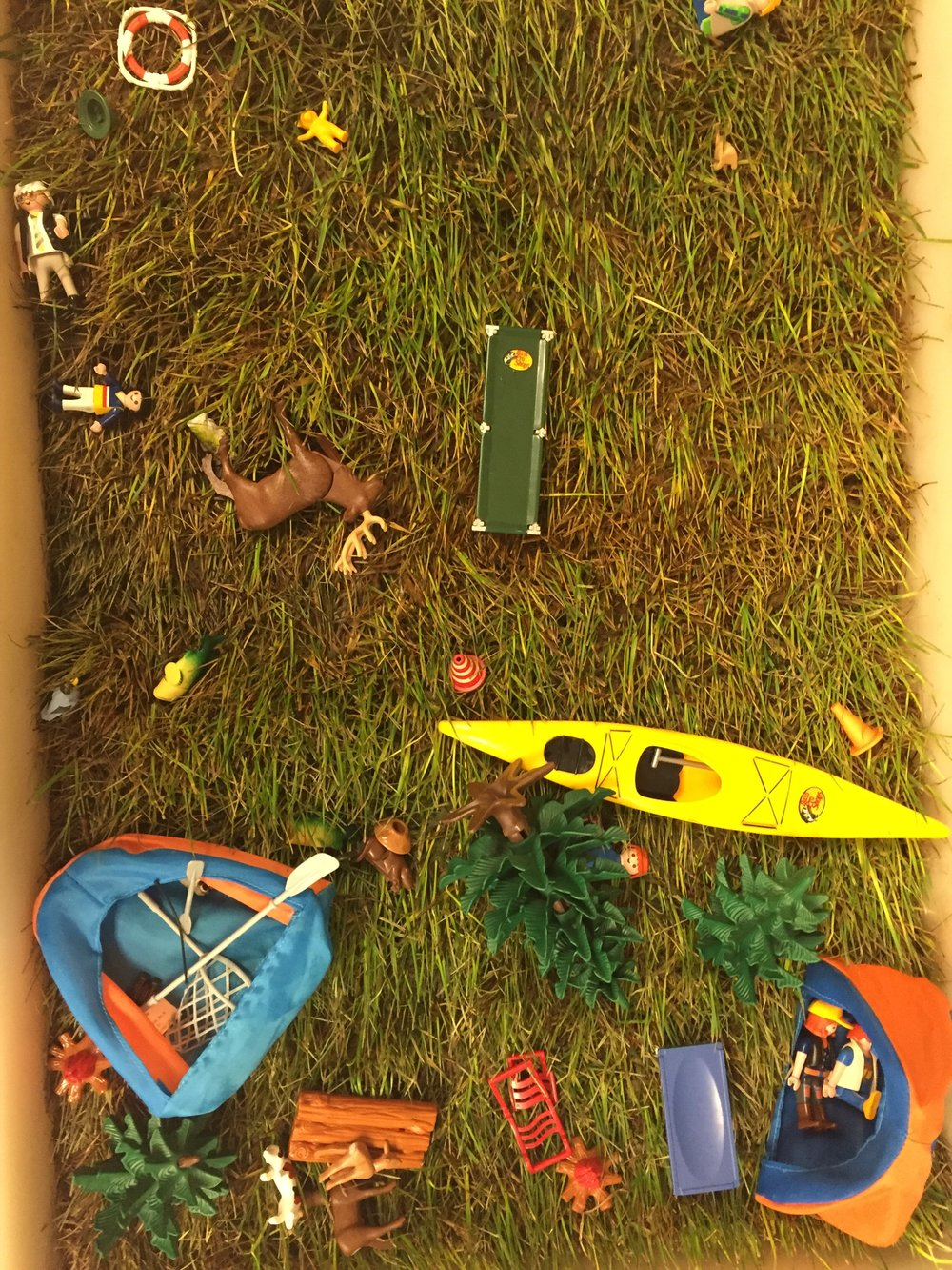 The idea for this center came out of having this camping set given to our classroom. I just added a piece of sod (I checked that no one had allergies to grass) and the toys and that was that.  Fun sensory bins do not always have to be complicated and time-consuming to create.