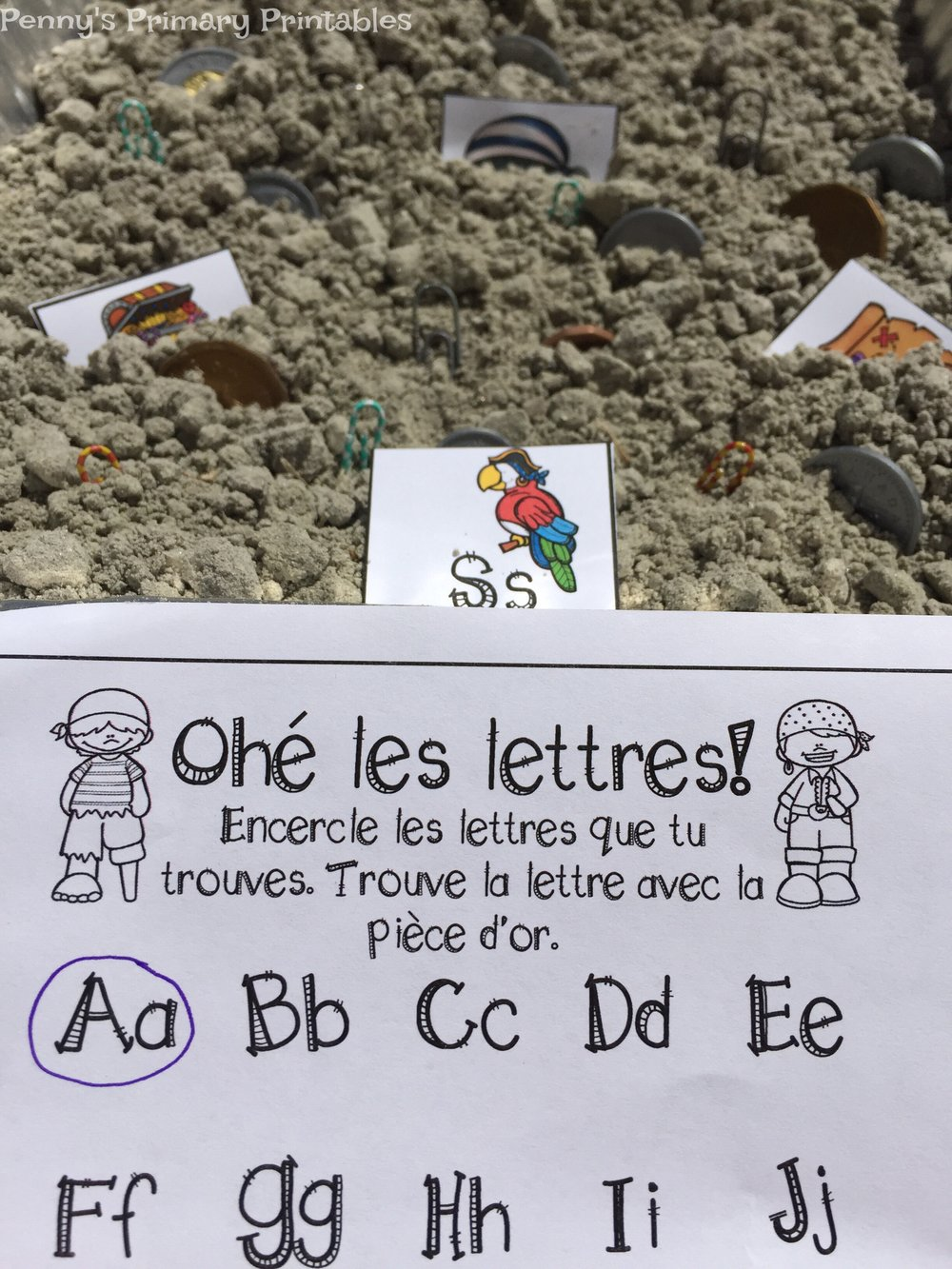 This is one of two activities that you can use with the included alphabet letters. I like to use them in a sensory bin that is the same theme as the dramatic play center. You could also hide them around the room. This bin was easy to prepare as I buried the cards and some treasures in the sand. This activity is the easier of the two as students need to find and circle the letters of the alphabet and find the special golden coin card.