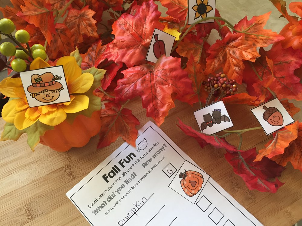 Students will love this fun counting center, they need to search and find all the fall items and count how many of each there are. I like hiding the cards in a fall themed sensory bin, but you could also hide them around the room. To make an easy sensory bin I cut the leaves off of garlands I found at the dollar store.