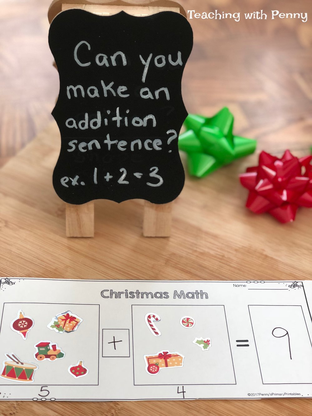 I used the template with Christmas stickers to create a fun addition center with a fine motor element. Students love peeling and sticking stickers.