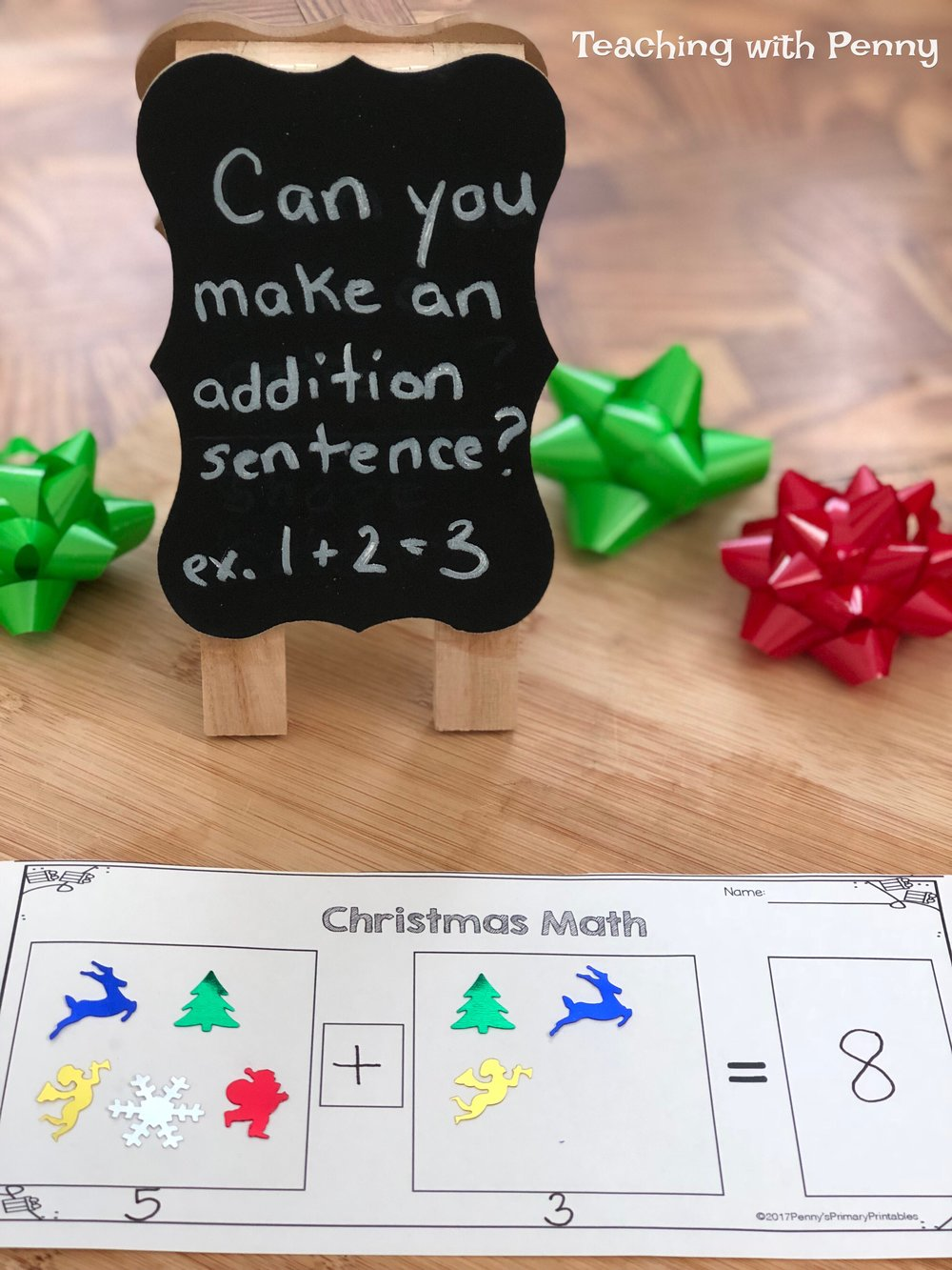 Christmas confetti is perfect for making addition sentences. Grab the free printable at the end of the post! You can use it with any Christmas items or have students draw pictures instead. You can find similar Christmas confetti on Amazon  here .