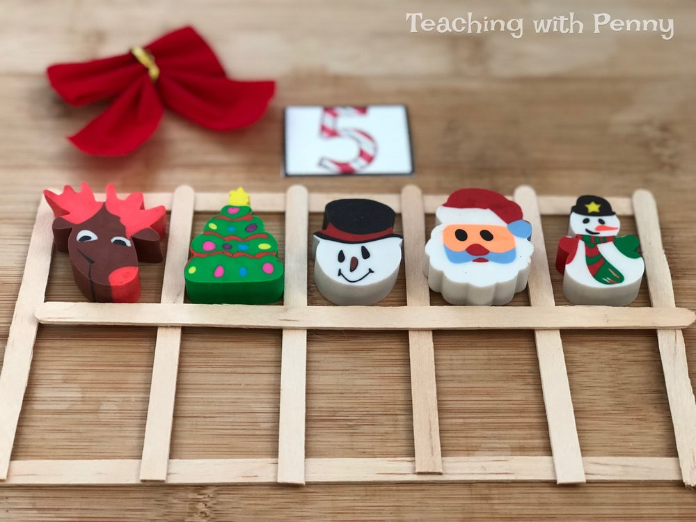 I have used these popsicle stick ten frames over and over for many different centers. They are great for addition, counting, subitizing, etc. This center is very easy to put together, all you need are some math manipulatives for counting-like these cute mini erasers and foam stickers. I printed off some Christmas clip art numbers to put out at the centers to provide guidance. You can find similar Christmas mini erasers on Amazon  here .