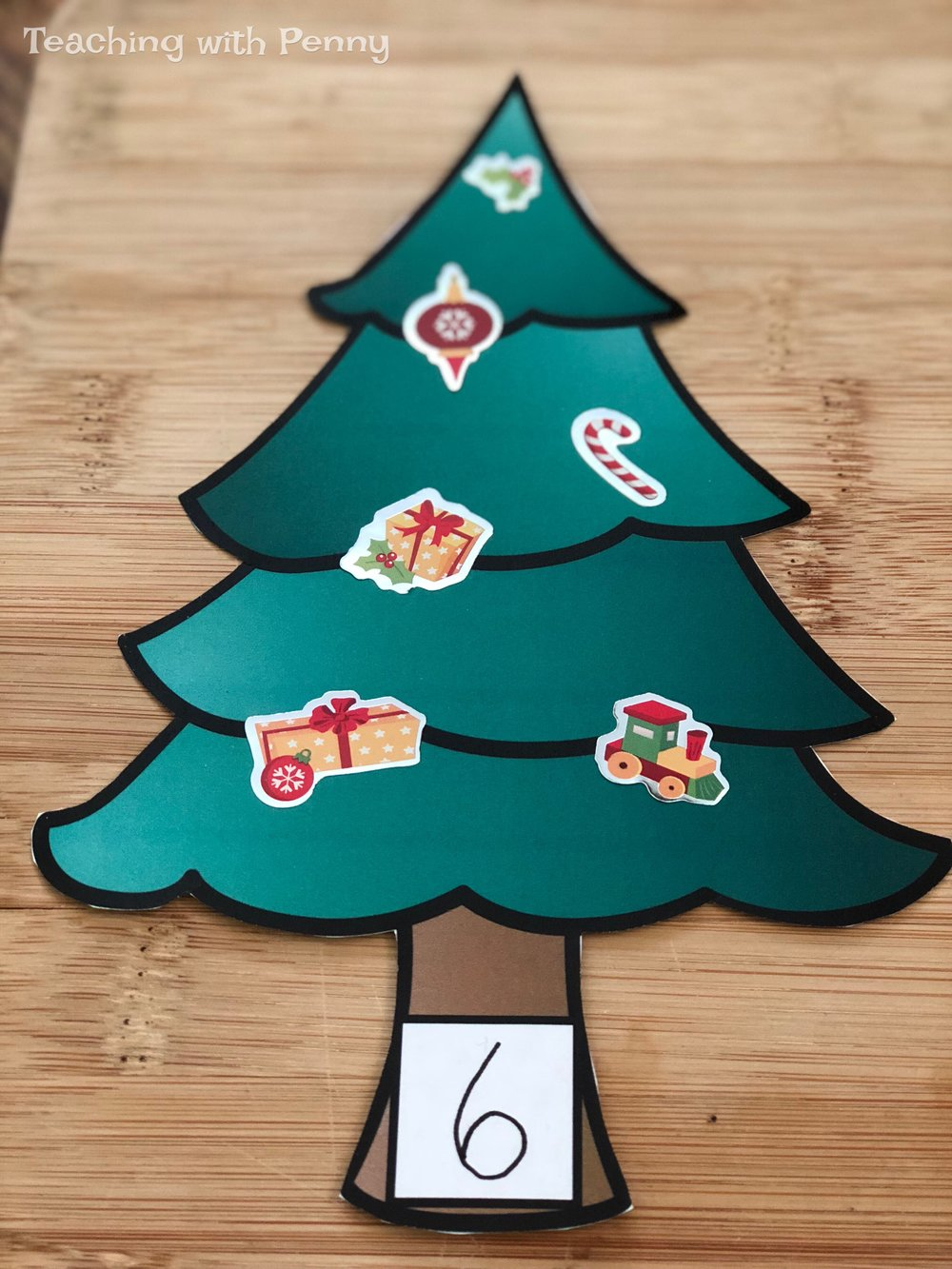 I included these free tree templates that you can use for counting, just print as many as you need and add the numbers. I used stickers because I had students hand these in and I used them to decorate the room. To save on printing just laminate them and have students place non-sticking objects on top. If you want to use this idea another way you could also cut trees out of construction paper.