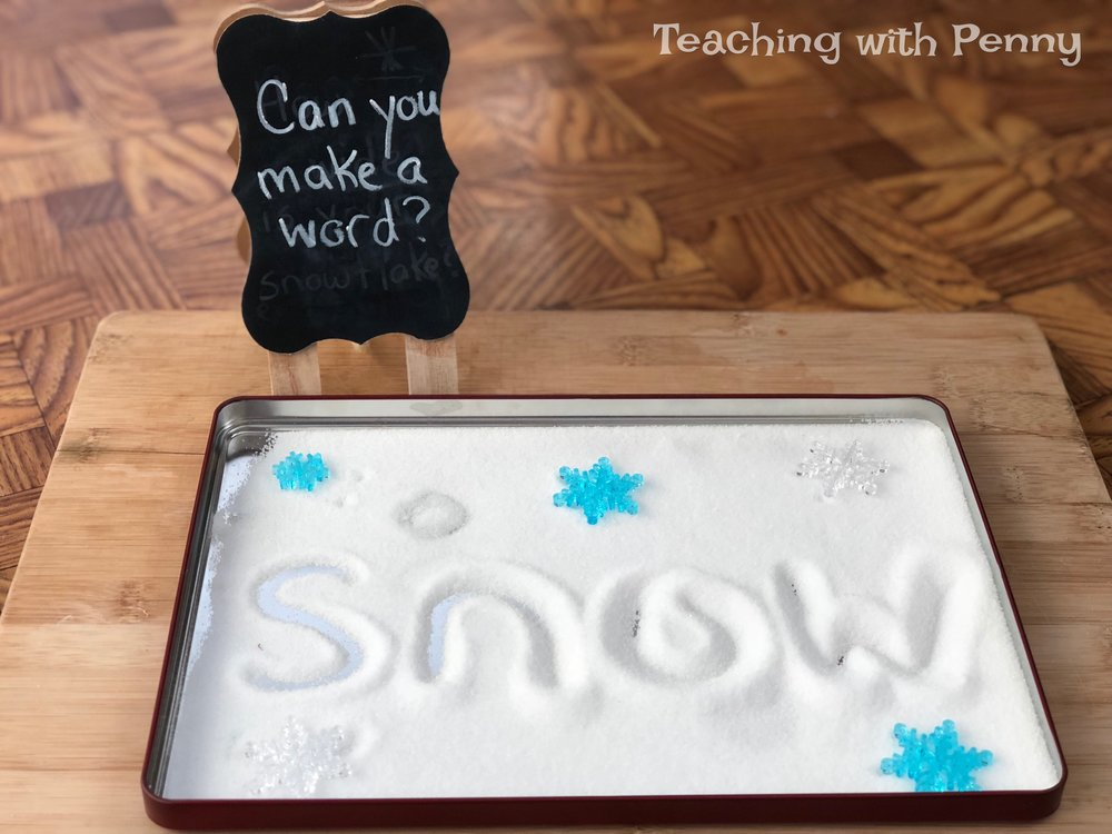This salt tray center is so easy to set-up, all you need is salt and a tray. I used the lids from tin cookie boxes. A box of salt is inexpensive at the grocery store and all you need is enough to cover the top of the tray. I put out vocab cards with winter words (see the end of the post for the set I used) so if they wanted to they could practise more complex words. For lower students they could draw letters in the salt instead.