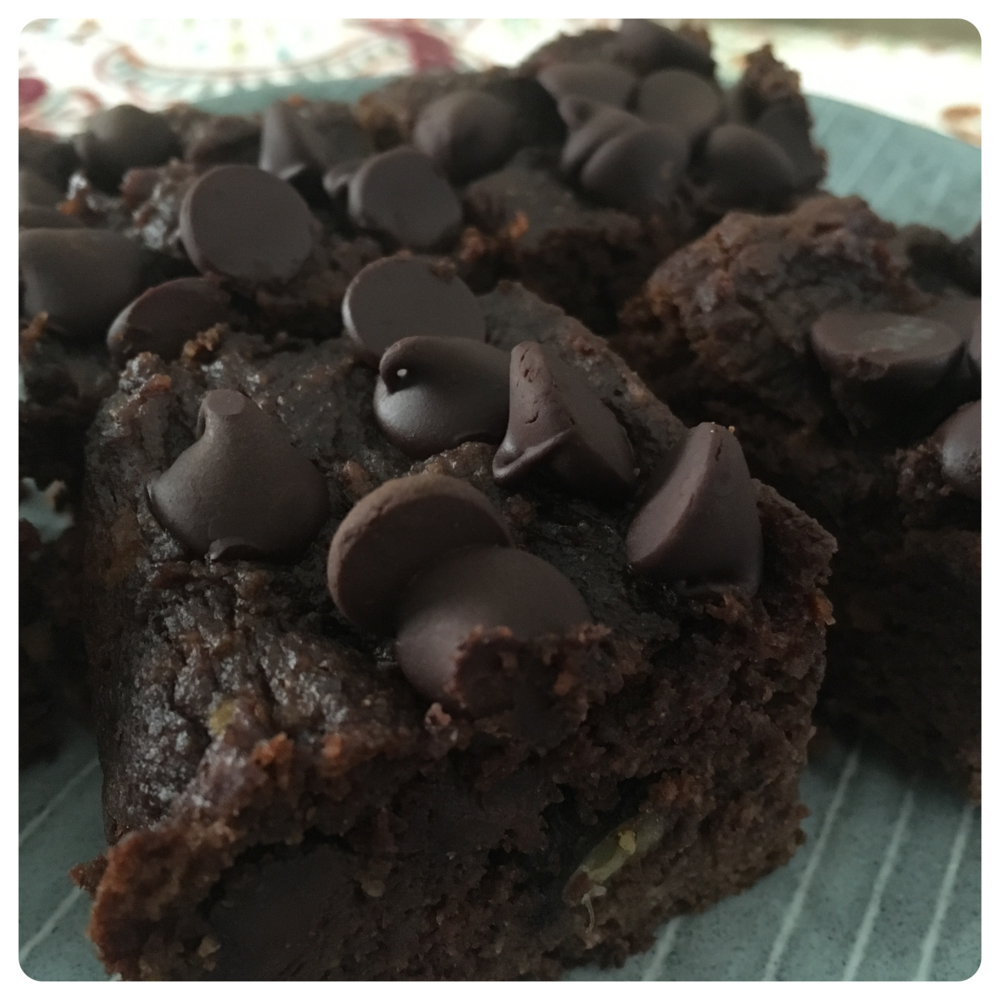 Chocolate Avocado Cake Squares   Dry Ingredients:  2 cups Almond Flour 1/4 cup Raw Cacao Powder 1/2 cup Chopped Walnuts 1 tsp Baking Soda 1/2 tsp Salt 2/3 cup Chocolate Chips (1/3 for batter, 1/3 to sprinkle on top)                        Wet Ingredients:  1 1/2 cups Avocado(ripe) 3 tbsp Butter, softened or melted 3 tbsp Coconut Oil, melted 3 tbsp Raw Honey 2 Eggs 1 tsp Vanilla Extract  Directions:  1.  Pre-heat the oven to 350 degrees °F. Line an 8X8 pan with parchment paper. 2.  In a large bowl combine dry ingredients. 3.  In a food processor (or blender) mix the wet ingredients until smooth, starting with the avocado. 4.  Mix the wet and dry ingredients together. 5.  Pour batter into the prepared 8X8 pan and sprinkle with additional 1/3 cup of chocolate chips. Bake for 25-30 minutes, or until a toothpick comes out clean. When the bars are done, let cool.