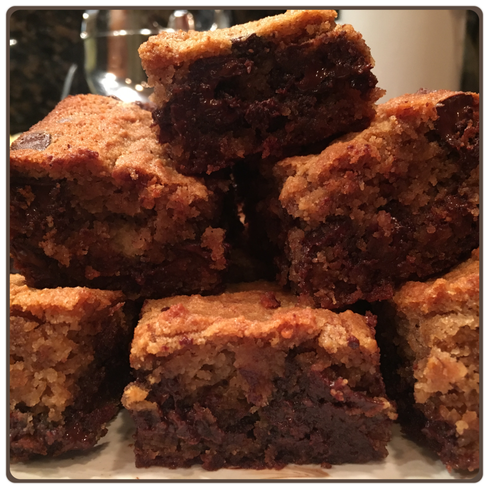 Banana Chocolate Chip Blondies   Dry Ingredients:  3 cups Almond Flour 1 tsp Baking Soda    3/4 tsp Nutmeg 1/2  tsp Salt 1 1/2 cups Chocolate Chips  Wet Ingredients:  2 Bananas (ripe) 1/4 cup Coconut Oil 2 tsp MCT Oil (or more Coconut Oil) 6 tbsp Butter (softened) 1/4 cup Honey 1/4 cup Almond Butter   2 Eggs                                  1 tsp Vanilla Extract                                           Directions:  1.  Pre-heat the oven to 350 degrees °F. Grease an 8X8 pan with coconut oil or butter. 2.  In a small bowl combine dry ingredients. 3.  In a food processor, blender or with an electric mixer combine the wet ingredients until smooth, starting with the bananas. 4.  Mix the wet and dry ingredients together. 5.  Pour batter into the prepared 8X8 pan. Bake for 25-30 minutes, or until a toothpick comes out clean. When the blondies are done, let cool.