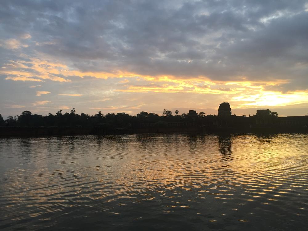 Across the moat at Angkor Wat at sunrise.
