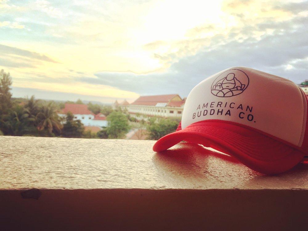 American Buddha Co. Original trucker hat during sunrise at the Royal Angkor Resort.