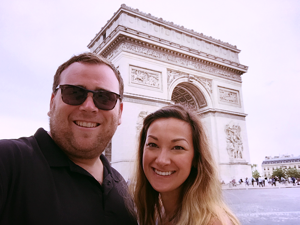 Adrian and Ashlee outside the Arc de Triomphe de l'Étoile -- careful crossing the street!