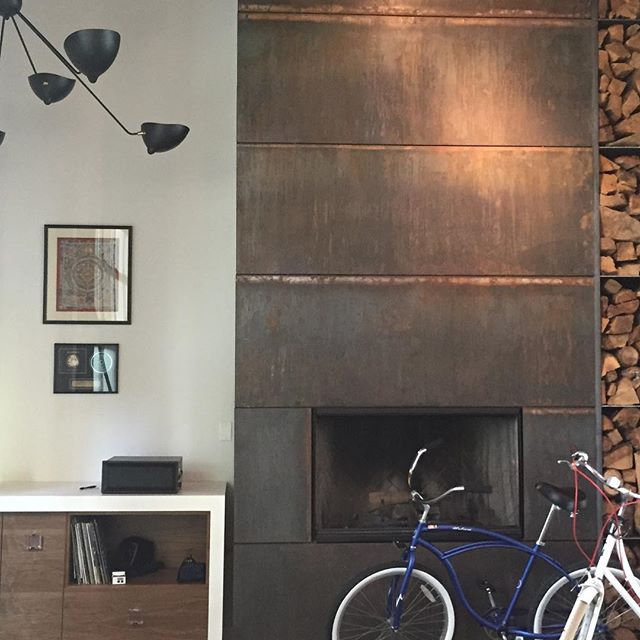 Custom walnut and stone DJ station and all metal fireplace Surround design by @tammyedmondsdesign @luxemagazine #fireplace #venicebeach #loft #music