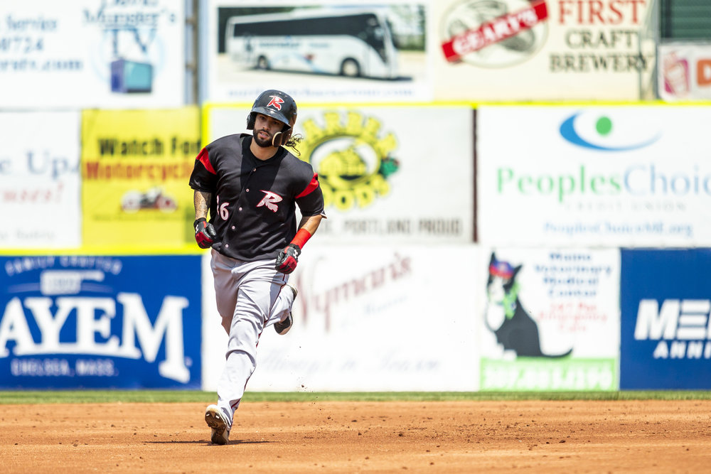 PORTLAND, ME - AUGUST 05:  C.J Hinojosa #26 of the Richmond Flying Squirrels rounds third base after hitting a home run in the second inning of a game against the Portland Sea Dogs on August 5, 2018, in Portland, ME at Hadlock Field. (Photo by Zachary Roy/Getty Images)