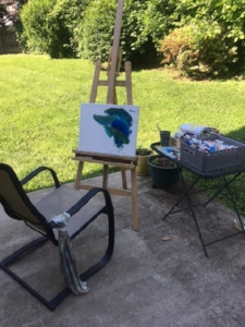 Painting in the backyard.