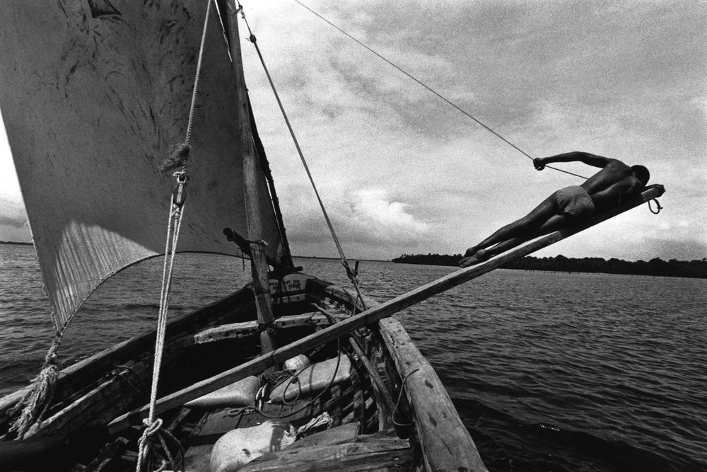'Trapeze' A sailor upon the trapeze off the coast of Mombasa, Kenya. 1999