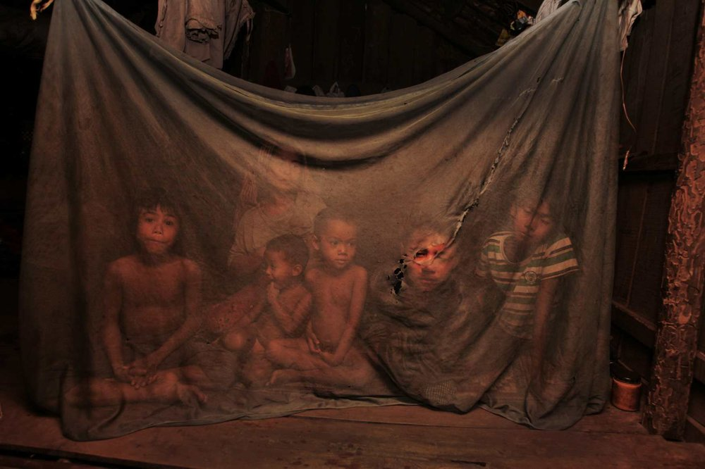 Mother Leng Bo with her family in their hut in the village of Loveathon, Cambodia. 2009
