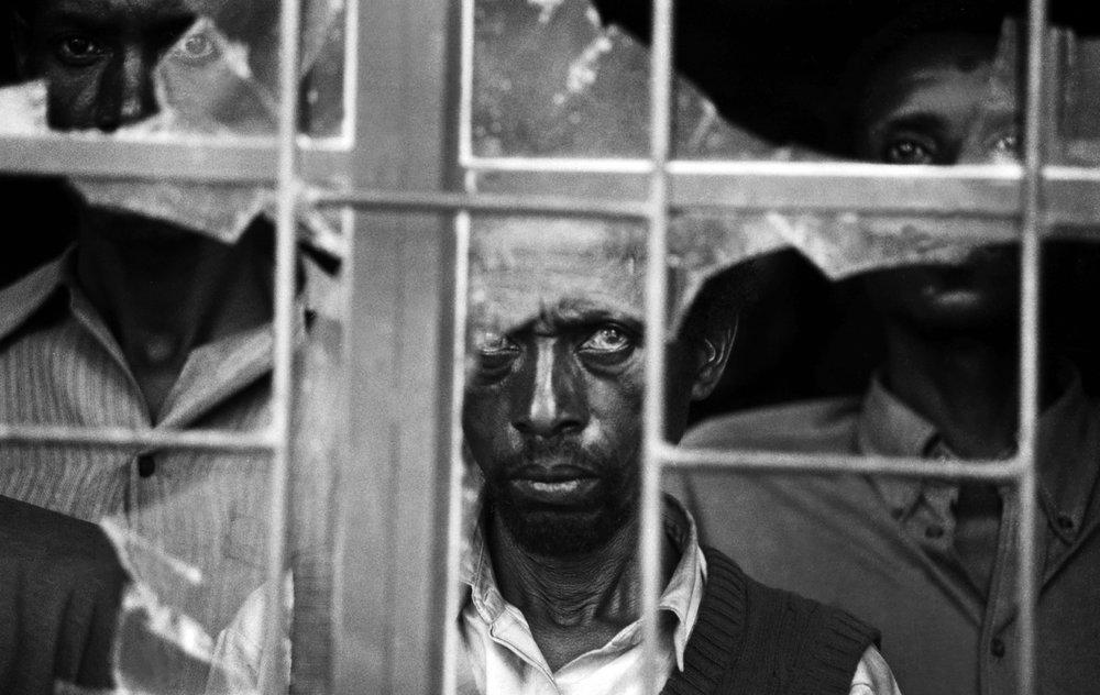 Suspected Hutu killers held captive by RPF soldiers in a Belgian Catholic Church in Rukara.Rwanda,  ©  Jack Picone