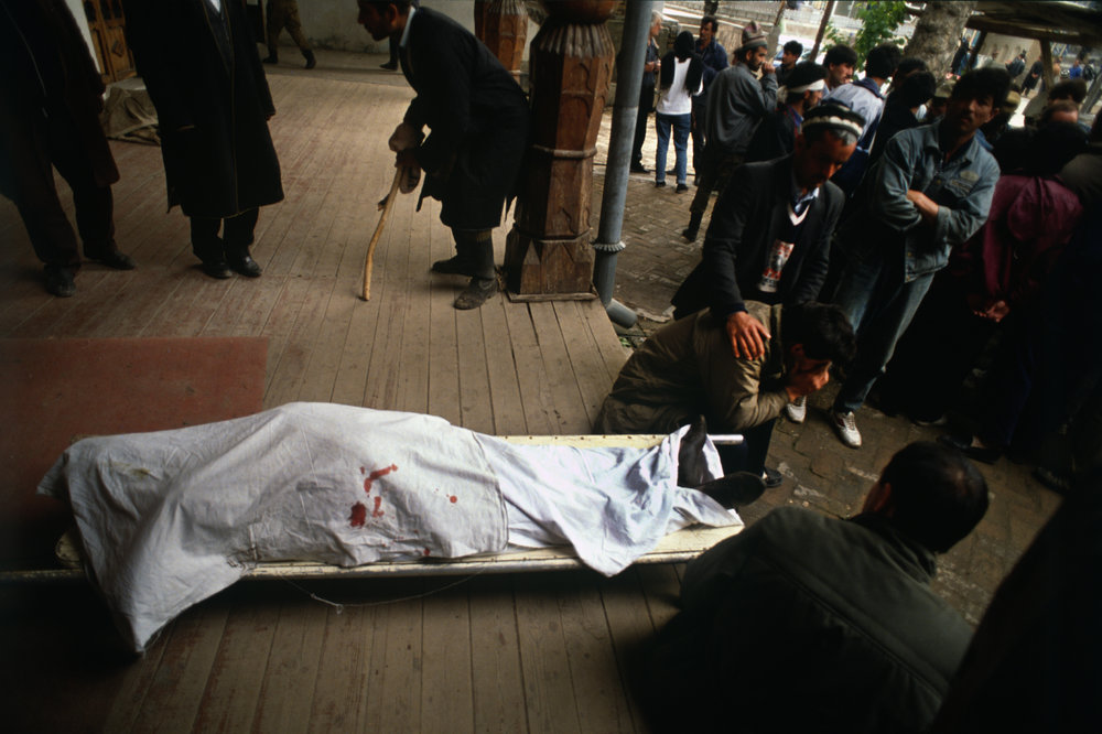 Islamic Renaissance party member shot dead, (headshot)  by a government sniper in Dushanbe, Tajikistan. The Islamic Renaissance Party were fighting to overthrow the Soviet backed government in power. Tajikistan, 1992