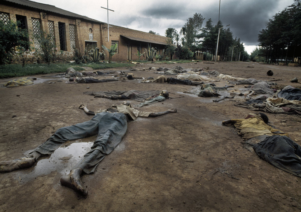 Corpses of Tutu massacre victims outside a Belgian Catholic Church in Rukara.  Genocide, Rwanda, 1994