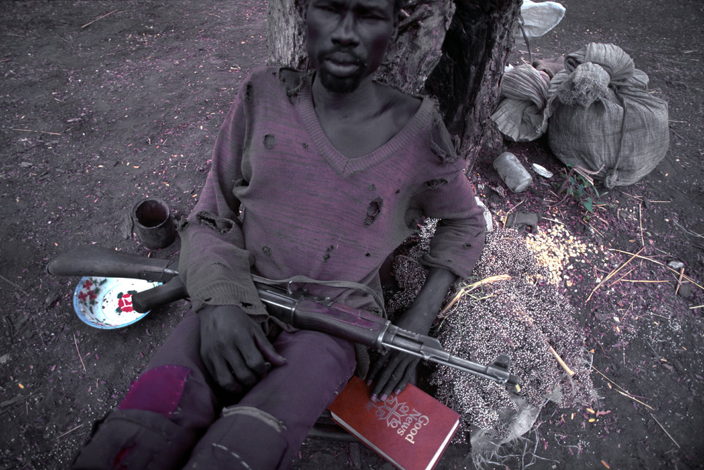 """Bible and Gun"" During Sudan's long running civil war. 1993"