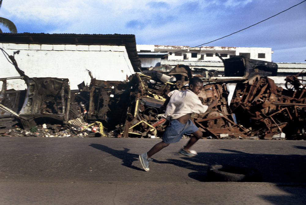 Monrovia's war damaged streets during The First Liberian Civil War which killed about 250,000 people. Monrovia, Liberia 1996
