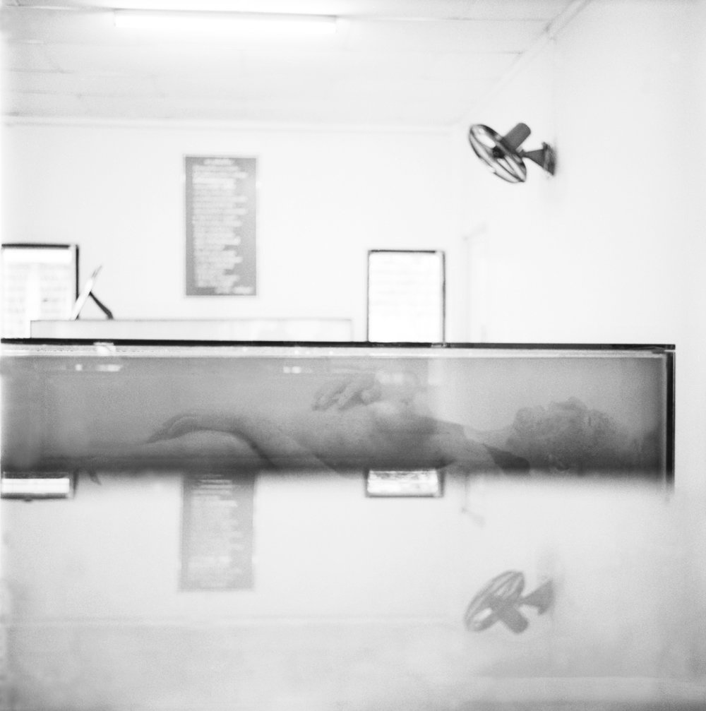 'Under Glass.' A deceased woman is exhibited at an AIDS museum in Lopburi, Thailand. 2003