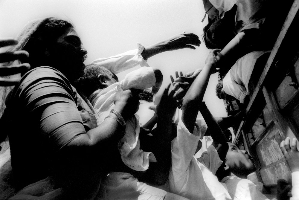 Maharashtra earthquake survivors receive aide. India, 1993