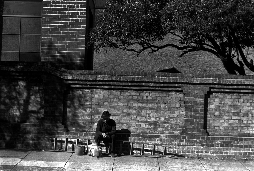 """Tradesman"" Waiting for a ride on Coogee Bay Rd Sydney, Australia. 1983"