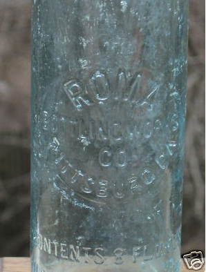 Early Roma Embossed Bottle